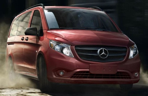 Red Mercedes-Benz Metris Passenger Van ruggedly approaches the camera.